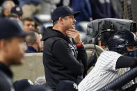 New York Yankees manager Aaron Boone watches the game from the dugout in the seventh inning of a baseball game against the Tampa Bay Rays, Friday, Oct. 1, 2021, in New York. (AP Photo/Mary Altaffer)