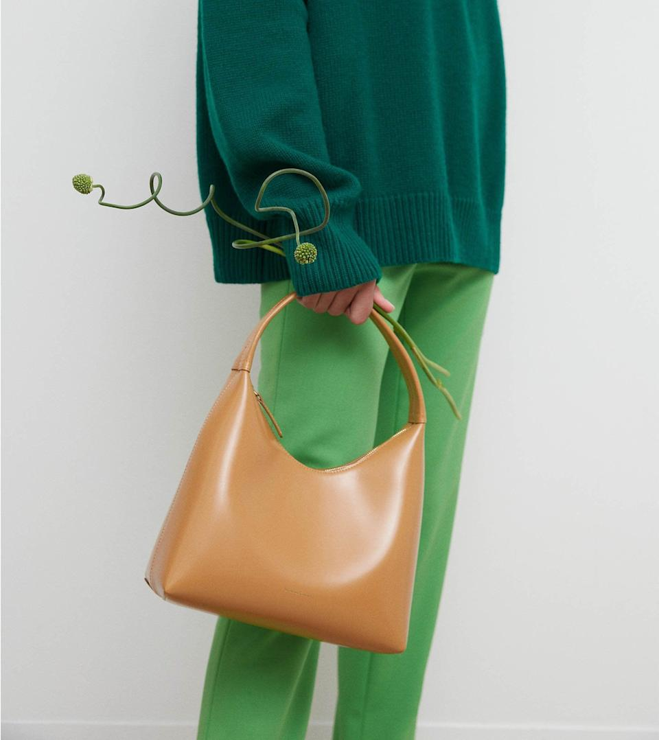 """<p>""""Sometimes I see something and just think to myself, 'Wow, that was made for me.' That's how I feel about the <span>Mansur Gavriel Candy Bag</span> ($495). The cool new silhouette is my favorite shape to carry, and the chic camel shade will match with all my favorite fall looks."""" - Krista Jones, editor, Commerce</p>"""