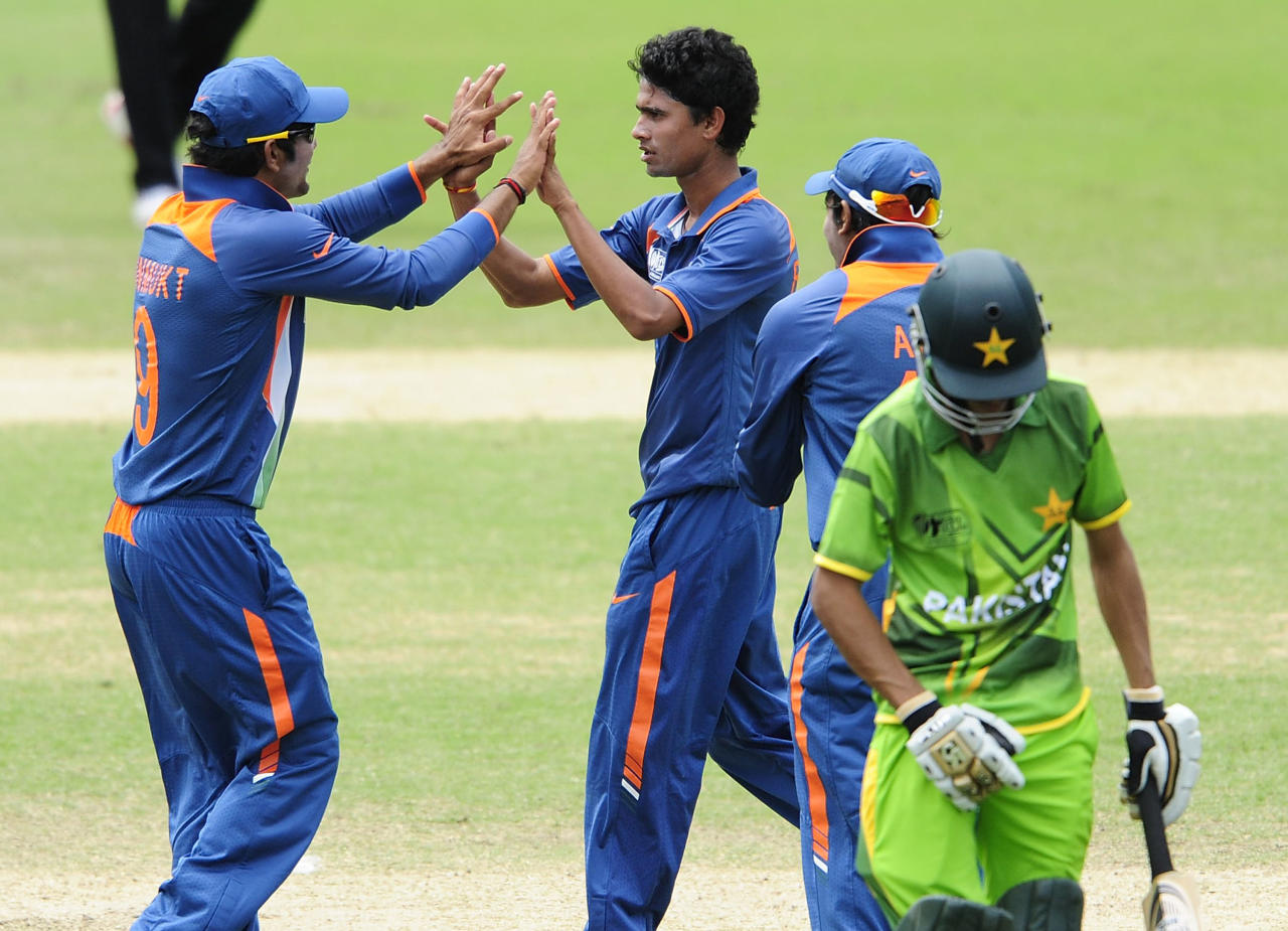 TOWNSVILLE, AUSTRALIA - AUGUST 20:  Ravikant Singh (c) of India celebrates the wicket Umar Waheed of Pakistan during the ICC U19 Cricket World Cup 2012 Quarter Final match between India and Pakistan at Tony Ireland Stadium on August 20, 2012 in Townsville, Australia.  (Photo by Ian Hitchcock-ICC/Getty Images)