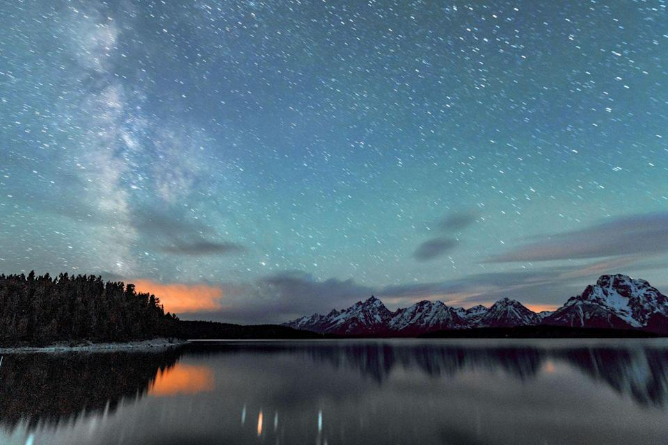 <p>Catch a glimpse of the Milky Way over Jackson Lake in Grand Teton National Park. This is a popular lake for fishing and boating during the warmer seasons.</p>