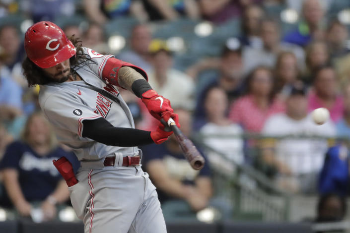 Cincinnati Reds' Jonathan India hits an RBI-double during the second inning of a baseball game against the Milwaukee Brewers, Monday, June 14, 2021, in Milwaukee. (AP Photo/Aaron Gash)