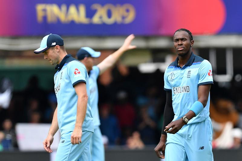 England's Jofra Archer (R) celebrates taking the wicket of New Zealand's Matt Henry for four runs during the 2019 Cricket World Cup final between England and New Zealand at Lord's Cricket Ground in London on July 14, 2019. (Photo by Paul ELLIS / AFP) / RESTRICTED TO EDITORIAL USE (Photo credit should read PAUL ELLIS/AFP/Getty Images)