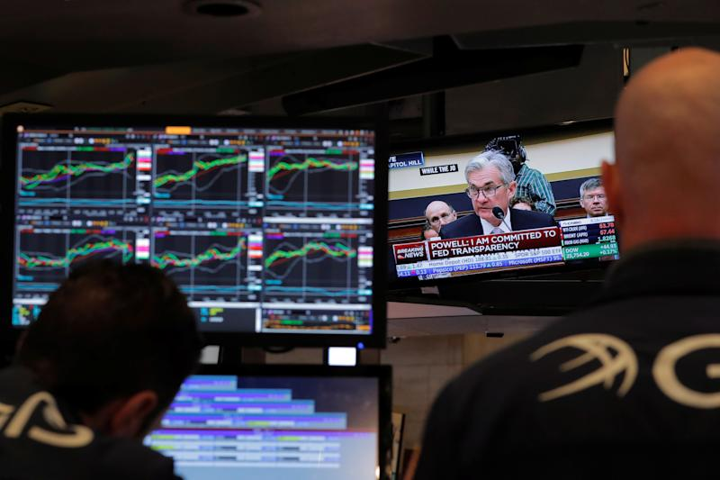 Federal Reserve Chairman Jerome Powell speaks on a television as traders work on the floor of the New York Stock Exchange in New York, U.S., February 27, 2018. REUTERS/Lucas Jackson
