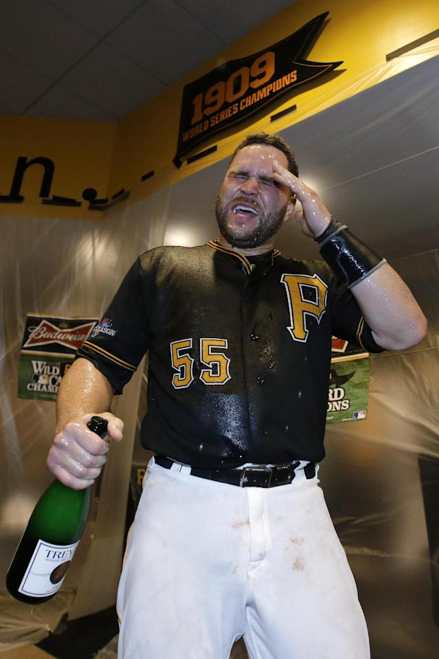 Pittsburgh Pirates' Russell Martin (55) joins in the celebration of the Pirates' 6-2 win over the Cincinnati Reds in the NL wild-card playoff baseball game in Pittsburgh on Tuesday, Oct. 1, 2013. Martin hit two home runs in the game. (AP Photo/Gene J. Puskar)