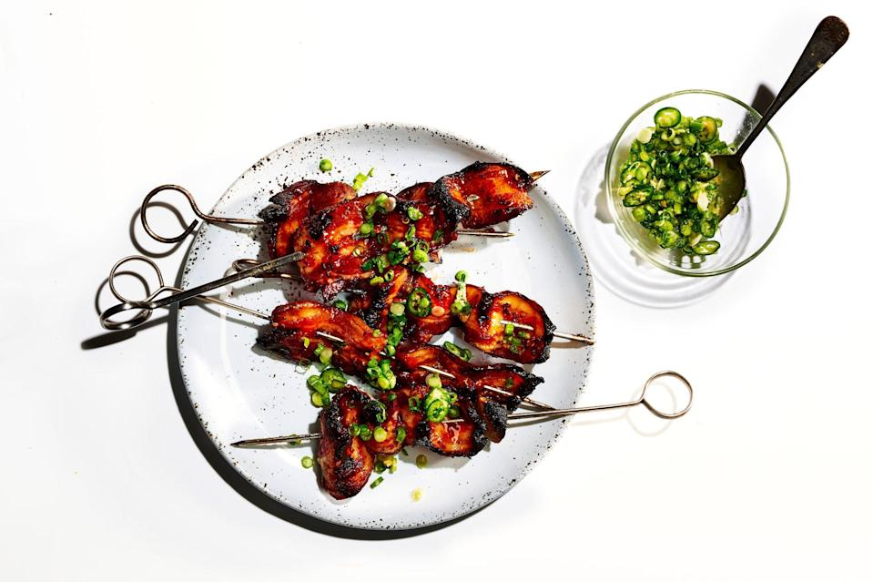 "Be patient with these; they need to stay over indirect heat the whole time to minimize flare-ups. If you try to rush them, they'll burn to a crisp. <a href=""https://www.bonappetit.com/recipe/sweet-spicy-bacon-kebabs-scallion-ginger-relish?mbid=synd_yahoo_rss"" rel=""nofollow noopener"" target=""_blank"" data-ylk=""slk:See recipe."" class=""link rapid-noclick-resp"">See recipe.</a>"