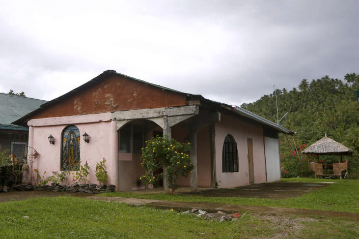 This Jan. 26, 2019 photo shows the convent next to the chapel built by American priest Father Pius Hendricks in the village of Talustusan on Biliran Island in the central Philippines. Since December 2018, the small village has been rocked by controversy after about 20 boys and men accused the Catholic parish priest of years of alleged sexual abuse. (AP Photo/Bullit Marquez)