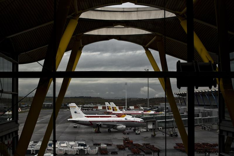 "Iberia jets are seen in a parking zone at Barajas international airport in Madrid, Friday, Nov. 9, 2012. International Airlines Group on Friday warned that its Spanish carrier Iberia was ""in a fight for survival"" and unveiled a restructuring plan to cut 4,500 jobs as it reported a drop in third-quarter profit. (AP Photo/Daniel Ochoa de Olza)"
