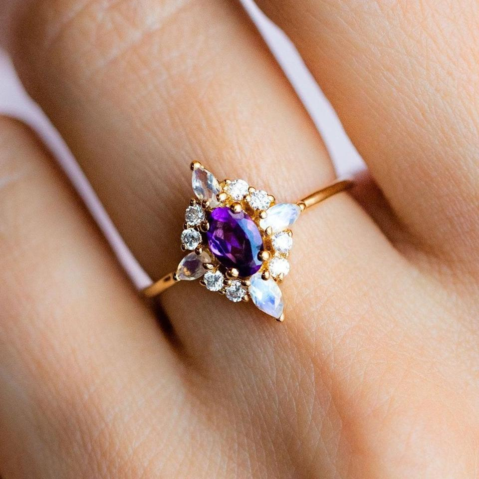"""<p>The <a href=""""https://www.popsugar.com/buy/Pink-Lady-Ring-Amethyst-531807?p_name=Pink%20Lady%20Ring%20With%20Amethyst&retailer=localeclectic.com&pid=531807&price=120&evar1=fab%3Aus&evar9=7954958&evar98=https%3A%2F%2Fwww.popsugar.com%2Fphoto-gallery%2F7954958%2Fimage%2F47032936%2FPink-Lady-Ring-With-Amethyst&list1=shopping%2Cwedding%2Cjewelry%2Crings%2Cengagement%20rings%2Cfashion%20shopping&prop13=api&pdata=1"""" rel=""""nofollow noopener"""" class=""""link rapid-noclick-resp"""" target=""""_blank"""" data-ylk=""""slk:Pink Lady Ring With Amethyst"""">Pink Lady Ring With Amethyst</a> ($120) is just plain gorgeous.</p>"""