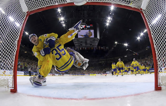 "Sweden's <a class=""link rapid-noclick-resp"" href=""/nhl/players/2645/"" data-ylk=""slk:Henrik Lundqvist"">Henrik Lundqvist</a> is hugged by his teammate <a class=""link rapid-noclick-resp"" href=""/nhl/players/6374/"" data-ylk=""slk:William Nylander"">William Nylander</a> after winning the Ice Hockey World Championships gold medal match between Canada and Sweden in the LANXESS arena in Cologne, Germany, Sunday, May 21, 2017. (Andre Ringuette/Pool Photo via AP)"