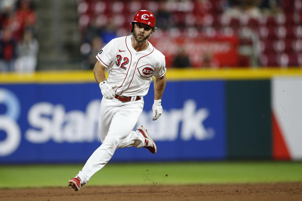 Cincinnati Reds' Max Schrock rounds second base on his way to a triple against the Washington Nationals during the ninth inning of a baseball game Thursday, Sept. 23, 2021, in Cincinnati. The Nationals beat the Reds 3-2. (AP Photo/Jay LaPrete)