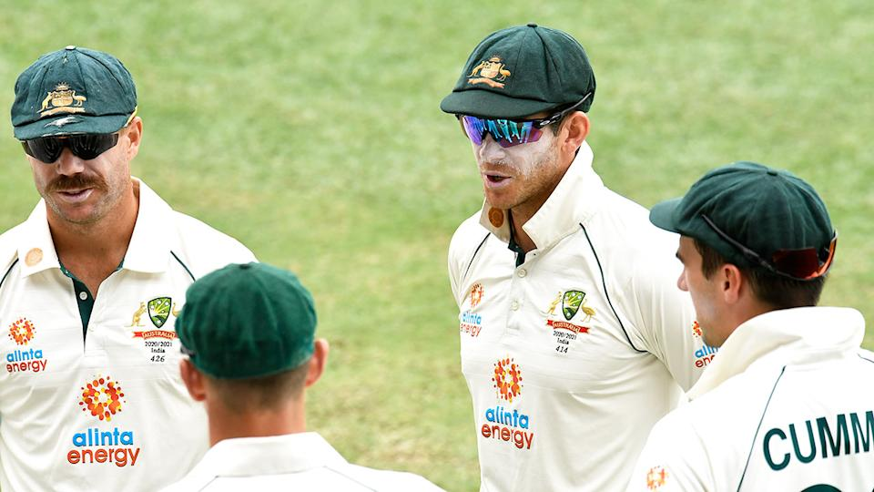Aussie captain Tim Paine is pictured here in discussions with his Test teammates.