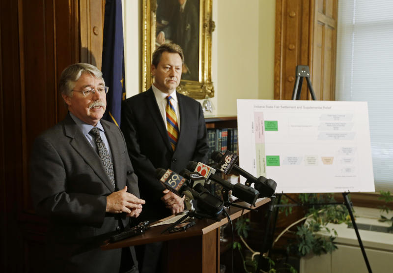 Indiana Attorney General Greg Zoeller, left, speaks as Bill Baten listens during a  news conference at the Statehouse Thursday, Dec. 20, 2012, in Indianapolis. Zoeller announced the details of the distribution of the $6 million in supplemental relief to victims of the Indiana State Fair stage collapse. (AP Photo/Darron Cummings)