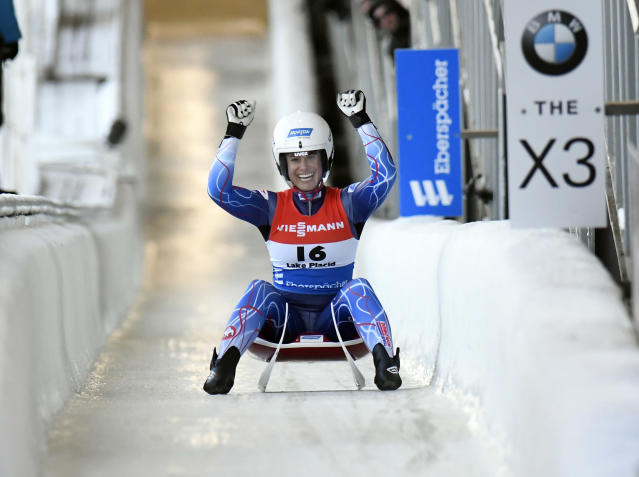 Emily Sweeney, of the United States, celebrates after her second place finish after completing her second run of a women's World Cup luge event in Lake Placid, N.Y., on Saturday, Nov. 30, 2019. (AP Photo/Hans Pennink)