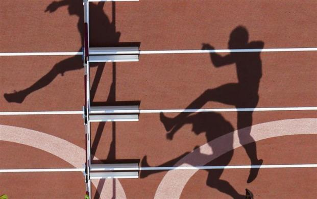 Athletes compete in the men's decathlon 110m hurdles heat at the London 2012 Olympic Games at the Olympic Stadium August 9, 2012.