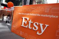 FILE PHOTO: A sign advertising the online seller Etsy Inc. is seen outside the Nasdaq market site in Times Square following Etsy's IPO in New York