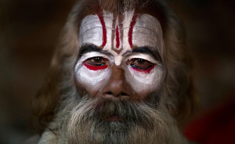 A Hindu holy man poses for a photograph as he smears his face with ash and vermilion powder at the courtyard of the Pashupatinath Temple during Shivaratri festival in Kathmandu, Nepal, Monday, March 4, 2019. Shivaratri, or the night of Shiva, is dedicated to the worship of Lord Shiva, the Hindu god of death and destruction. (Photo: Niranjan Shrestha/AP)