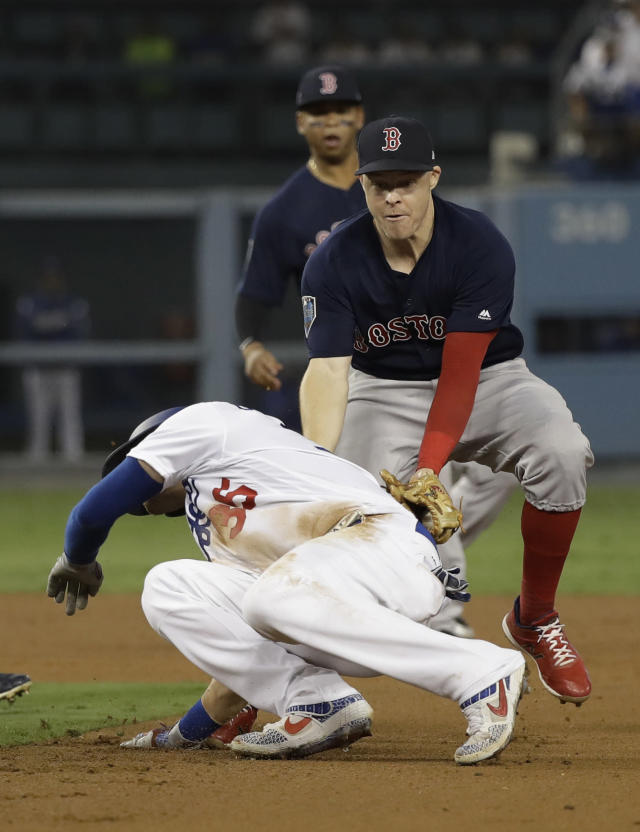 Boston Red Sox Brock Holt tags out Los Angeles Dodgers' Cody Bellinger in a rundown during the ninth inning in Game 3 of the World Series baseball game on Friday, Oct. 26, 2018, in Los Angeles. (AP Photo/David J. Phillip)