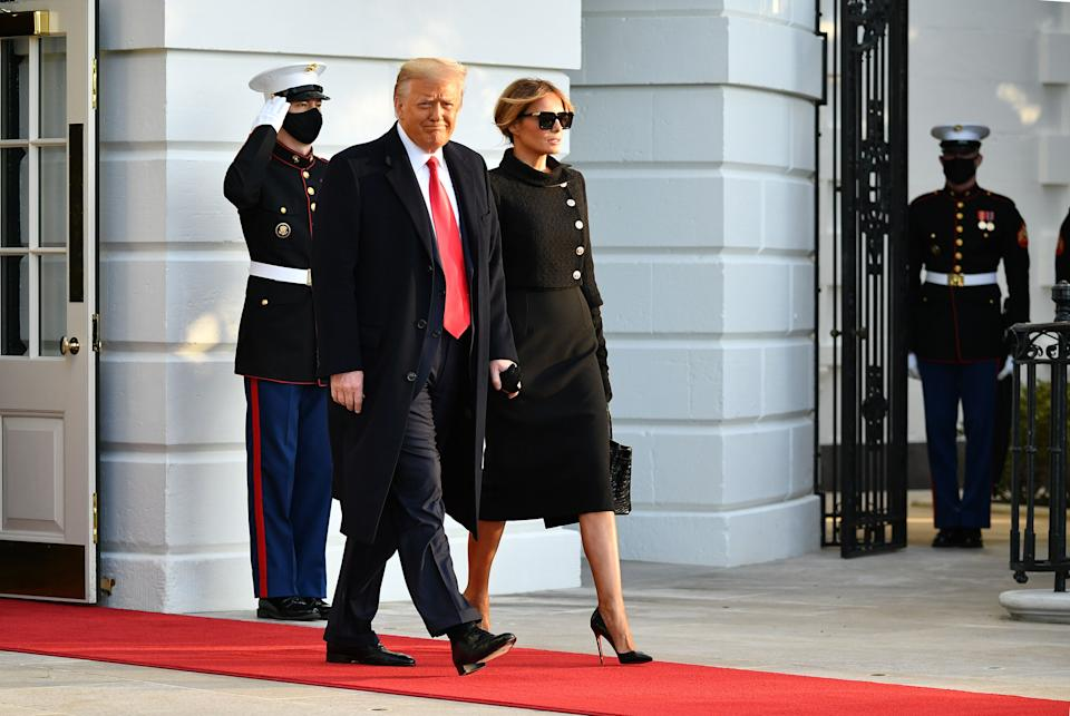 US President Donald Trump and First Lady Melania make their way to board Marine One before departing from the South Lawn of the White House in Washington, DC on January 20, 2021. - President Trump travels his Mar-a-Lago golf club residence in Palm Beach, Florida, and will not attend the inauguration for President-elect Joe Biden.