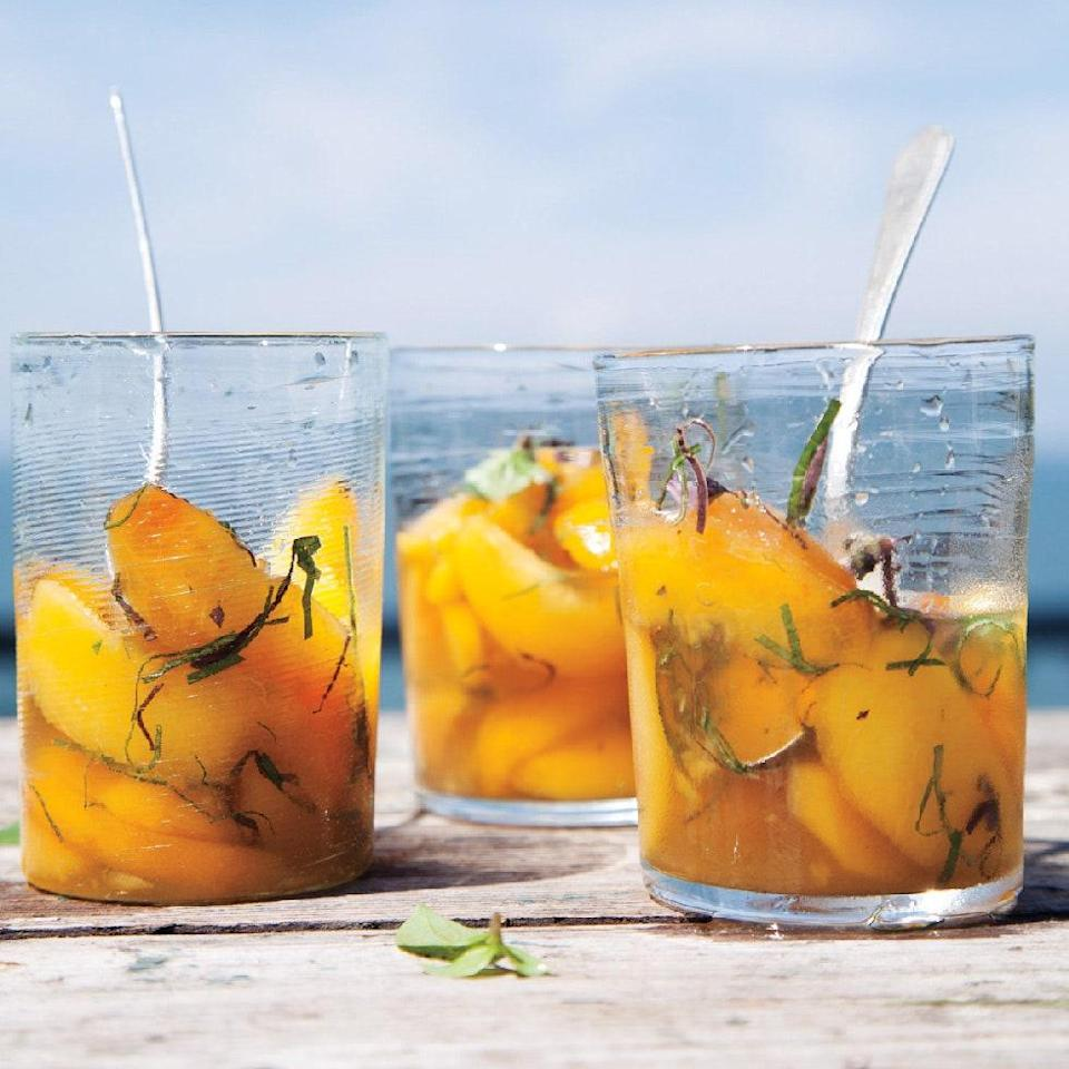 """Talk about a <a href=""""https://www.epicurious.com/recipes-menus/our-favorite-three-ingredient-recipes-gallery?mbid=synd_yahoo_rss"""" rel=""""nofollow noopener"""" target=""""_blank"""" data-ylk=""""slk:three-ingredient dessert"""" class=""""link rapid-noclick-resp"""">three-ingredient dessert</a>: All you need for this French-inspired summer dish is a bottle of the aperitif Lillet, a few sprigs of basil, and the sweetest, freshest peaches you can find. This would be lovely spooned over ice cream or <a href=""""https://www.epicurious.com/recipes/food/views/fresh-homemade-ricotta-234282?mbid=synd_yahoo_rss"""" rel=""""nofollow noopener"""" target=""""_blank"""" data-ylk=""""slk:fresh ricotta"""" class=""""link rapid-noclick-resp"""">fresh ricotta</a>. <a href=""""https://www.epicurious.com/recipes/food/views/peaches-in-lillet-51175490?mbid=synd_yahoo_rss"""" rel=""""nofollow noopener"""" target=""""_blank"""" data-ylk=""""slk:See recipe."""" class=""""link rapid-noclick-resp"""">See recipe.</a>"""