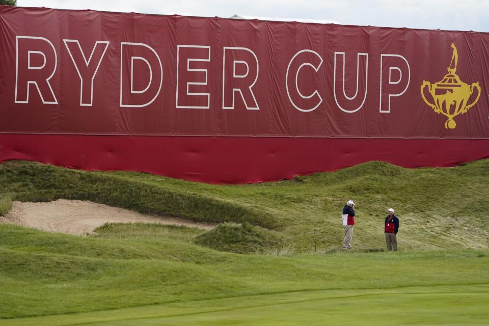Marshalls stand near the green on the first hole during a practice day at the Ryder Cup at the Whistling Straits Golf Course Wednesday, Sept. 22, 2021, in Sheboygan, Wis. (AP Photo/Jeff Roberson)