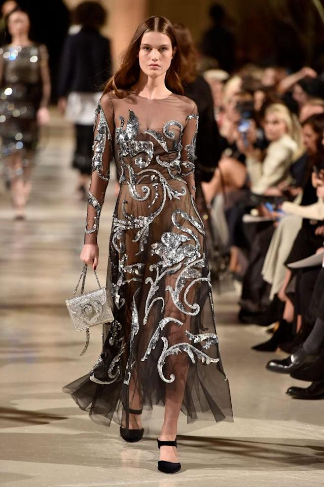 <p>A sheer and metallic-embroidered dress at the Oscar de la Renta FW18 show. (Photo: Getty) </p>