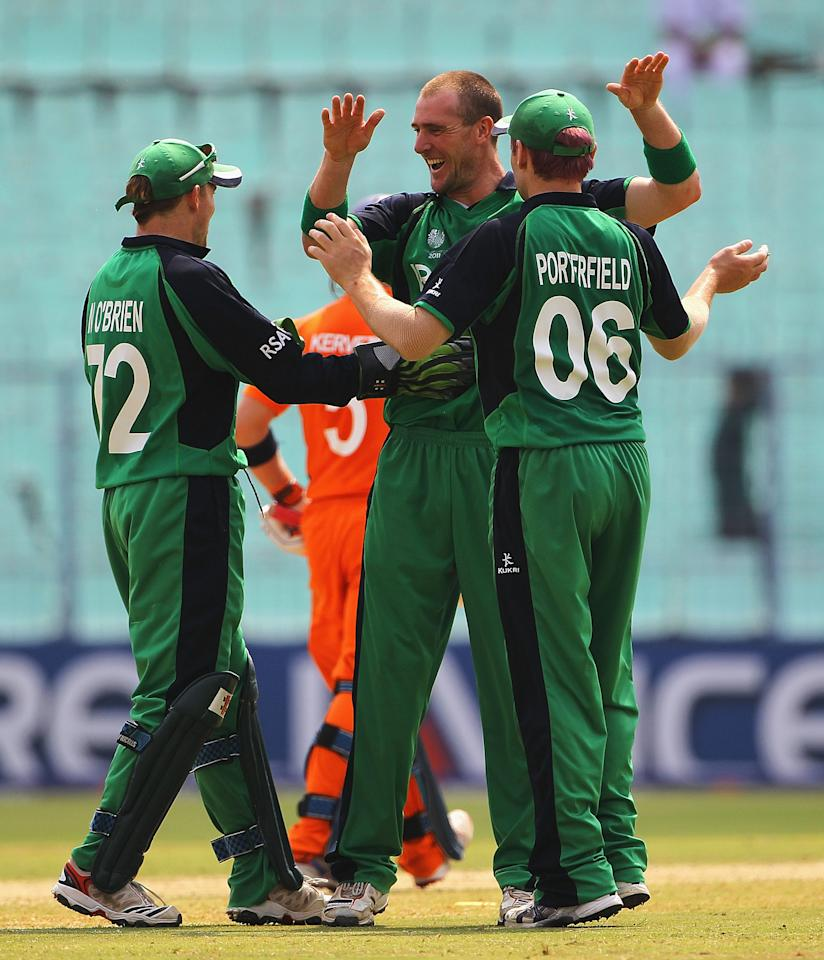 KOLKATA, INDIA - MARCH 18:  John Mooney of Ireland is congratulated by Niall O'Brien and William Porterfield, after Alexei Kervezee of the Netherlands was caught by Kevin O'Brien during the 2011 ICC World Cup match between Ireland and Netherlands at Eden Gardens on March 18, 2011 in Kolkata, India.  (Photo by Matthew Lewis/Getty Images)