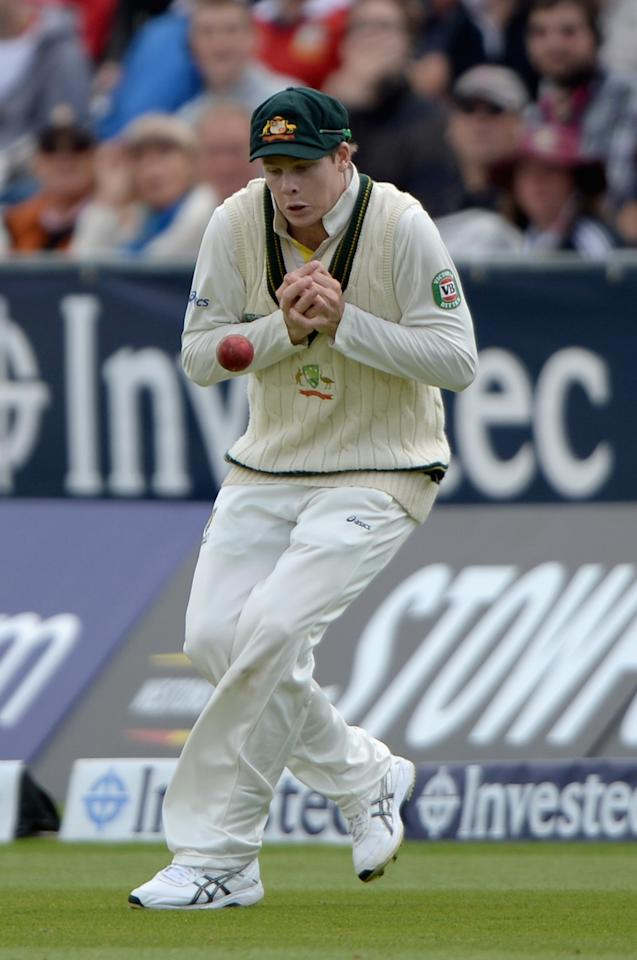 CHESTER-LE-STREET, ENGLAND - AUGUST 12:  Steve Smith of Australia drops a catch from the batting of Graeme Swann of England during day four of 4th Investec Ashes Test match between England and Australia at Emirates Durham ICG on August 12, 2013 in Chester-le-Street, England.  (Photo by Gareth Copley/Getty Images)