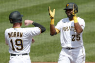 Pittsburgh Pirates' Gregory Polanco (25) celebrates with Colin Moran (19) after driving him and Bryan Reynolds in with a three run home run in the second inning of a baseball game against the Minnesota Twins, Thursday, Aug. 6, 2020, in Pittsburgh. (AP Photo/Keith Srakocic)