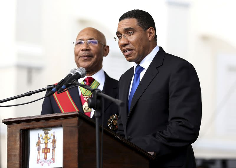FILE PHOTO: Jamaica's Prime Minister Andrew Holness addresses the audience next to Jamaica's Governor-General Sir Patrick Allen during his swearing-in ceremony in Kingston