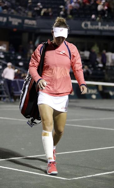 Samantha Stosur, of Australia, walks off the court after retiring in the second set to Eugenie Bouchard, of Canada, at the Family Circle Cup tennis tournament in Charleston, S.C., Thursday, April 4, 2013. Stosur retired in the second set due to an injury. (AP Photo/Mic Smith)