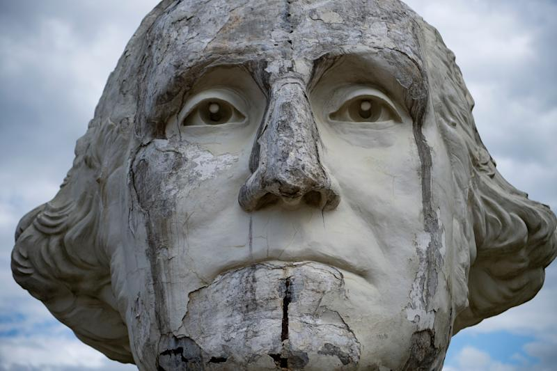 A decaying salvaged bust of former President George Washington is seen at a mulching business August 25, 2019, in Williamsburg, Virginia. (Photo: Brendan Smialowski/AFP/Getty Images)
