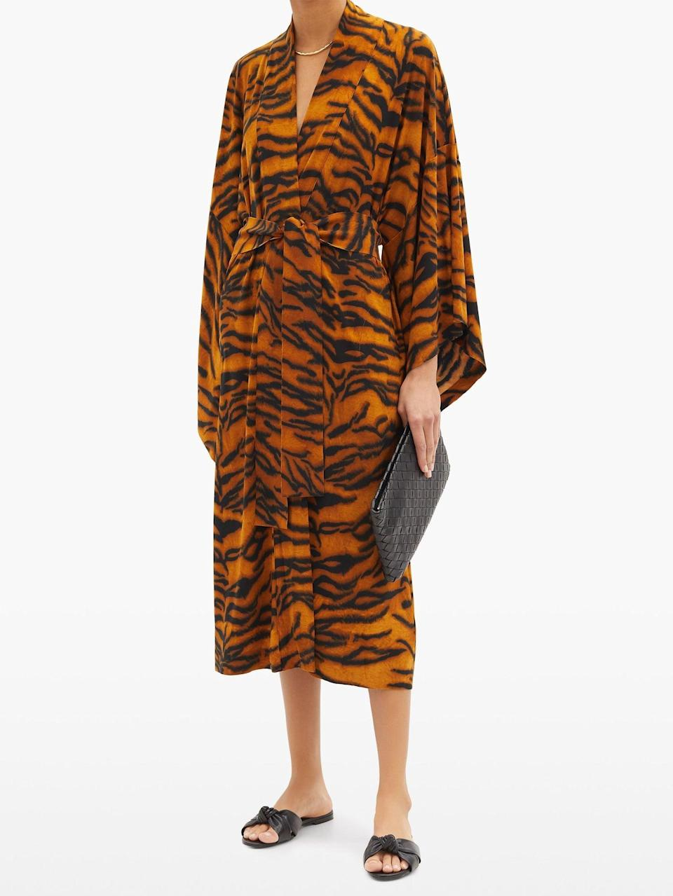 """<br><br><strong>Norma Kamali</strong> Tiger-Print Jersey Robe, $, available at <a href=""""https://go.skimresources.com/?id=30283X879131&url=https%3A%2F%2Fwww.matchesfashion.com%2Fproducts%2FNorma-Kamali-Tiger-print-jersey-robe-1398360"""" rel=""""nofollow noopener"""" target=""""_blank"""" data-ylk=""""slk:MatchesFashion"""" class=""""link rapid-noclick-resp"""">MatchesFashion</a>"""