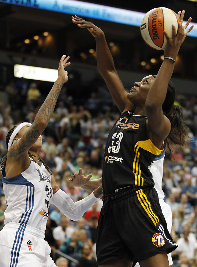 Tulsa Shock forward Tiffany Jackson-Jones, right, goes to the basket against guard Minnesota Lynx Seimone Augustus, left, in the first half of a WNBA basketball game on Friday, Aug. 16, 2013, in Minneapolis. (AP Photo/Stacy Bengs)