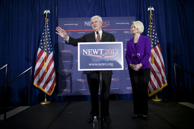 Republican presidential candidate, former House Speaker Newt Gingrich, accompanied by his wife Callista, speaks during a campaign stop in Dalton, Ga., Tuesday, Feb. 28, 2012. (AP Photo/Evan Vucci)