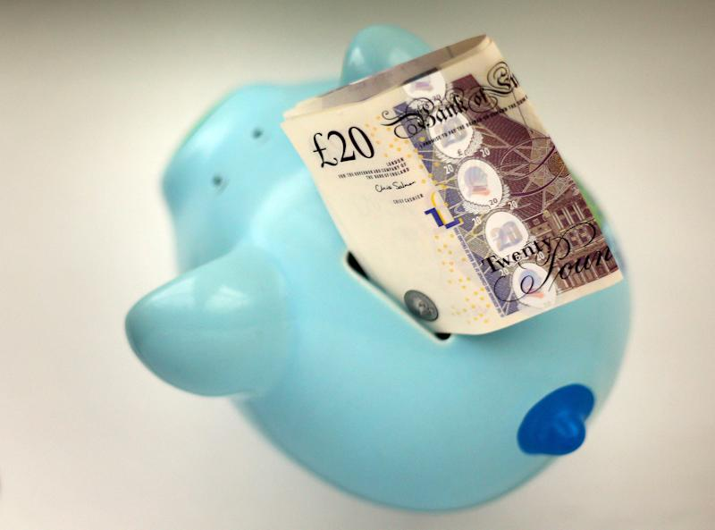 File photo dated 06/01/15 of money in a piggy bank. Pension providers are having to stand by and watch as customers transfer their life savings to potential scammers, a report claims.