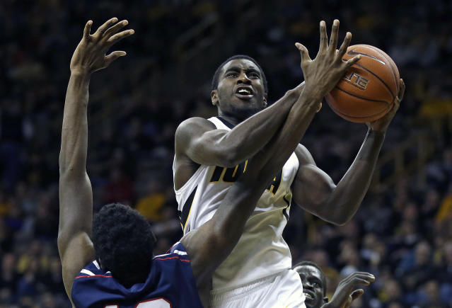 Iowa guard Anthony Clemmons shoots over Penn forward Dylan Jones, left, during the second half of an NCAA college basketball game, Friday, Nov. 22, 2013, in Iowa City, Iowa. Iowa won 86-55. (AP Photo/Charlie Neibergall)