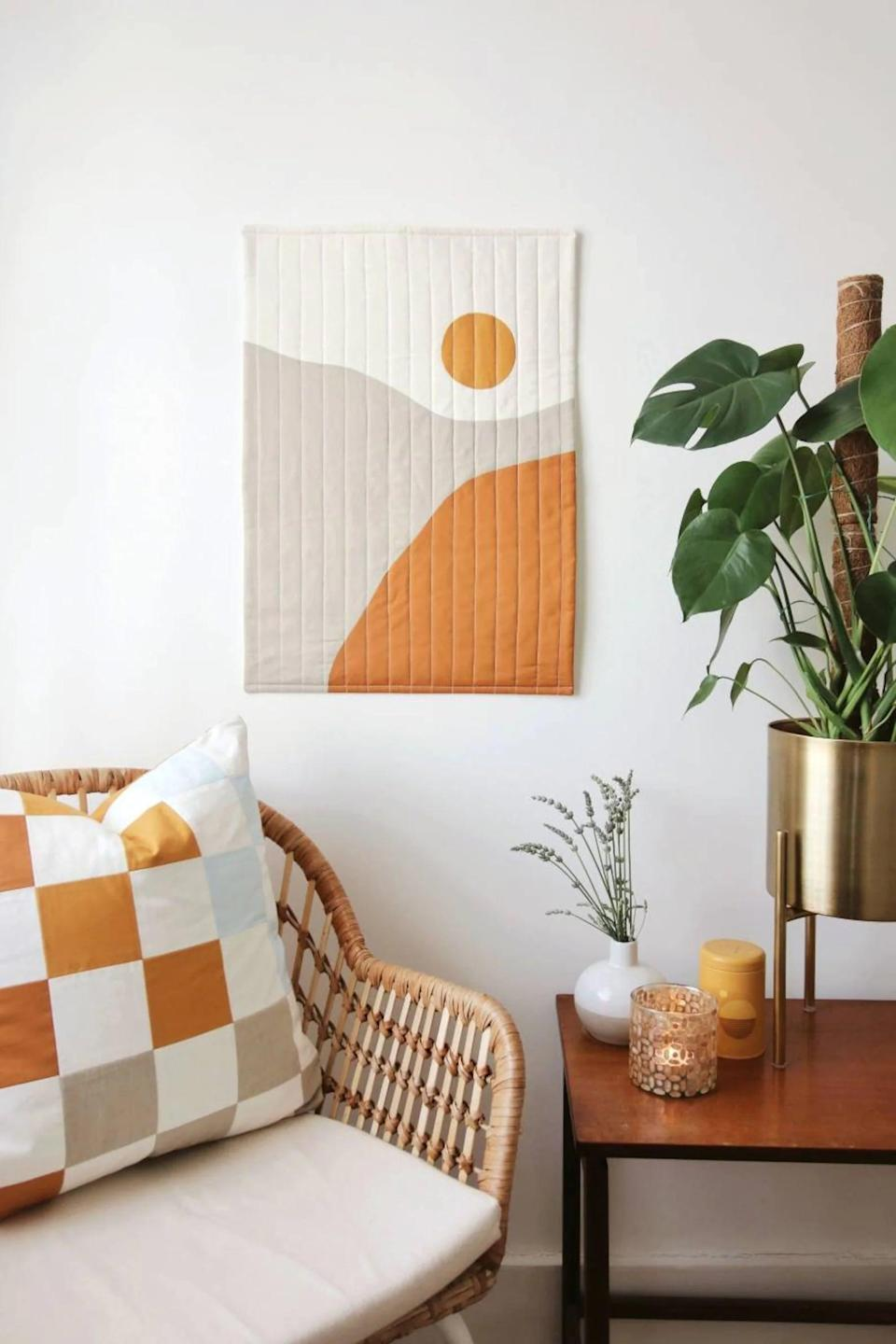 <p>This <span>Sunrise Modern Quilted Wall Decor</span> ($175) will add texture and color to your living room wall. It's an eye-catching piece that will have guests wondering where it's from.</p>