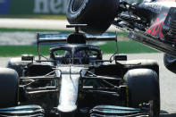 Mercedes driver Lewis Hamilton of Britain collides with Red Bull driver Max Verstappen of the Netherlands during the Italian Formula One Grand Prix, at Monza racetrack, in Monza, Italy, Sunday, Sept.12, 2021. (AP Photo/Luca Bruno)