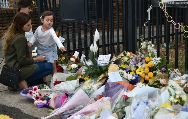 Hundreds of flowers have been laid at the Banksia Road Public School in Sydney's southwest. Source: Getty