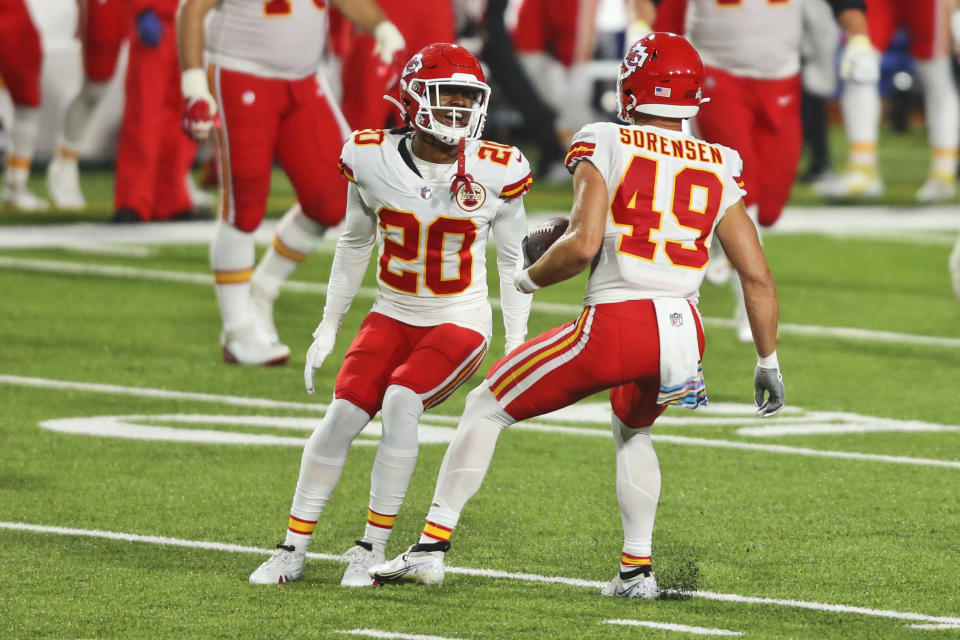 Kansas City Chiefs' Daniel Sorensen, right, celebrates his touchdown with Antonio Hamilton during the second half of an NFL football game against the Buffalo Bills, Monday, Oct. 19, 2020, in Orchard Park, N.Y. The Chiefs defeated the Bills 26-17. (AP Photo/Jeffrey T. Barnes)