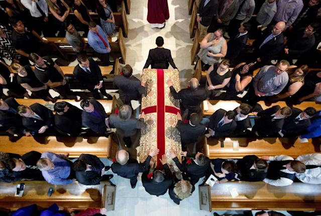 <p>The procession with the casket of Christopher Andrew Leinonen, one of the victims of the Pulse nightclub mass shooting, enters the Cathedral Church of St. Luke for his funeral service Saturday, June 18, 2016, in Orlando. Fla. (AP Photo/David Goldman) </p>