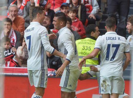 Football Soccer - Real Madrid v Athletic Bilbao- Spanish Liga Santander - San Mames, Bilbao, Spain - 18/03/17 Real Madrid's Cristiano Ronaldo, Carlos Casemiro, Lucas Vazquez and Sergio Ramos celebrate goal by Carlos Casemiro. REUTERS/Vincent West