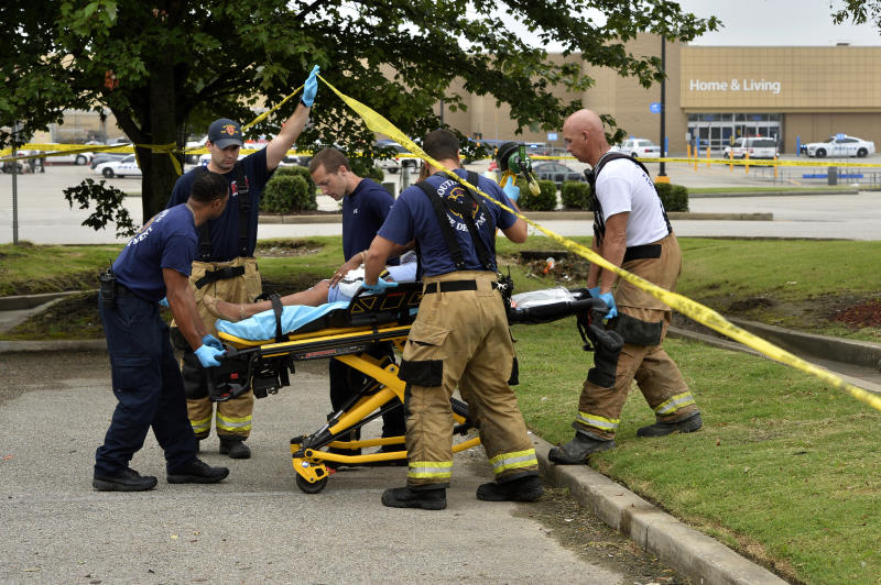 Paramedics offer medical attention after a shooting at a Walmart store Tuesday, July 30, 2019 in Southaven, Miss. (Photo: Brandon Dill/AP)