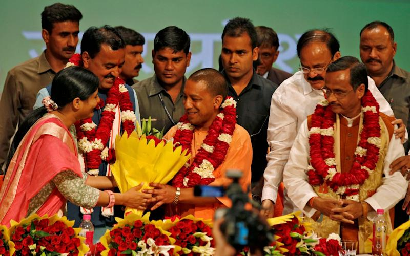 India's ruling Bharatiya Janata Party leader Yogi Adityanath is greeted after he was elected as Chief Minister of India's most populous state of Uttar Pradesh - Credit: Pawan Kumar/Reuters