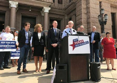 FILE PHOTO - Jeff Moseley, chief executive of the Texas Association of Business, speaks at a rally of business leaders rally in front of the Texas Capitol in Austin, Texas, U.S. on July 17, 2017.   REUTERS/Jon Herskovitz/File Photo