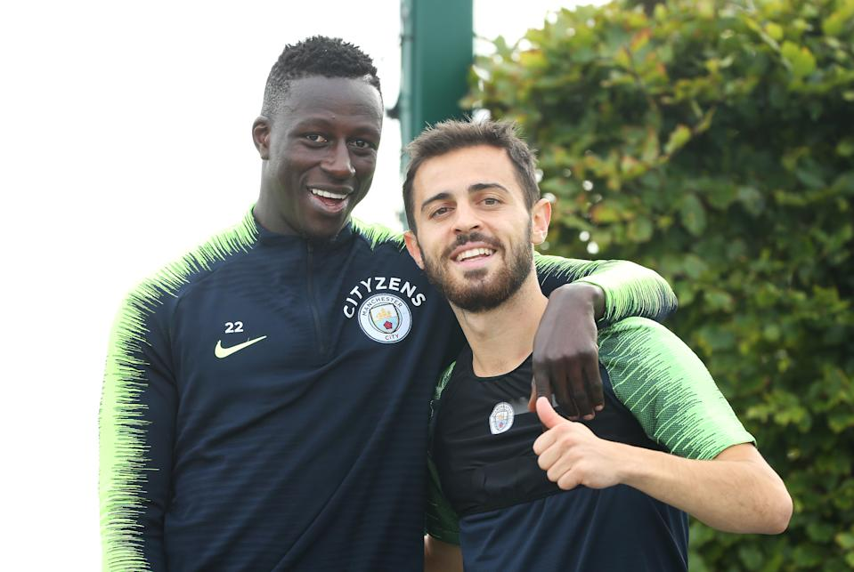 MANCHESTER, ENGLAND - AUGUST 30: Manchester City's Benjamin Mendy poses with Bernardo Silva during training at Manchester City Football Academy on August 30, 2018 in Manchester, England. (Photo by Tom Flathers/Manchester City FC via Getty Images)