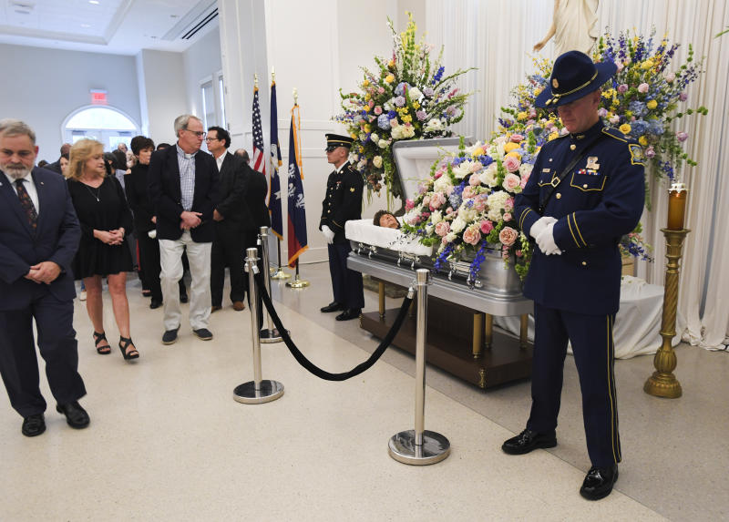 People file past the casket of former Louisiana Gov. Kathleen Blanco during a visitation at St. John's Cathedral Hall, Friday, Aug. 23, 2019, in Lafayette, La. Blanco, who served one term as governor and various elected positions across two decades, was in Louisiana's top job during the destruction of hurricanes Katrina and Rita in 2005. She died a week earlier from cancer. (Brad Kemp/The Advocate via AP)