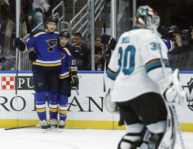 St. Louis Blues' Jaden Schwartz, center, is congratulated by Colton Parayko, left, as he celebrates after scoring past San Jose Sharks goaltender Aaron Dell, right, during the second period of an NHL hockey game Friday, Nov. 9, 2018, in St. Louis. (AP Photo/Jeff Roberson)