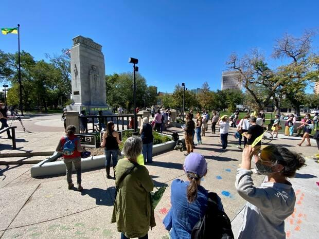 People attending a rally in downtown Regina on Wednesday demanded federal party leaders make climate change action a priority. (Matthew Howard/CBC - image credit)