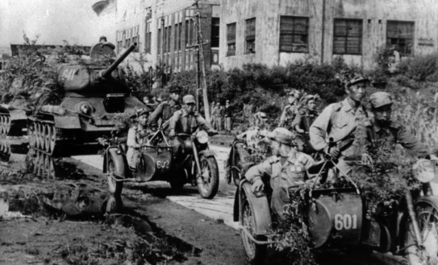 In this undated photo from North Korea's official Korean Central News Agency, distributed by Korea News Service, mechanized units from the (North) Korean People's Army enter the city of Taejon during the Korean War. (Photo: Korean Central News Agency/Korea News Service via AP Images)